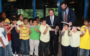 CE Astorino and Yonkers students cut the ribbon at the MRF